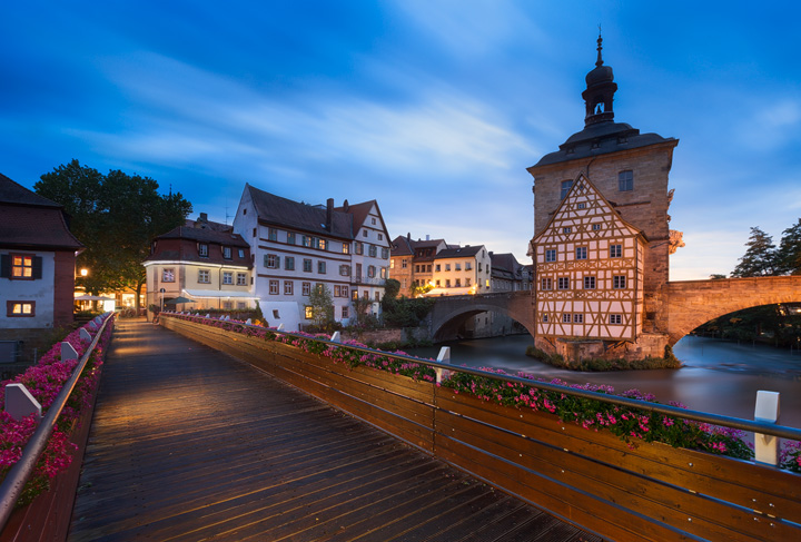 View across a bridge towards some historic buildings
