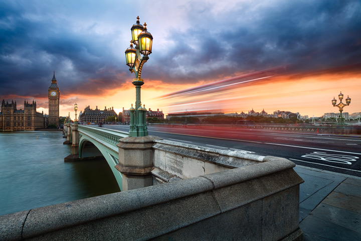 A dramatic sunset sky over Westminster bridge in London