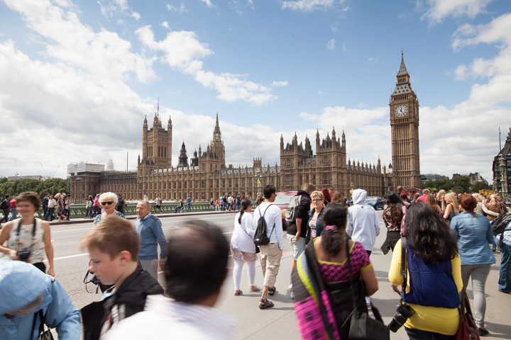 normal photo of Westminster with tourists in frame