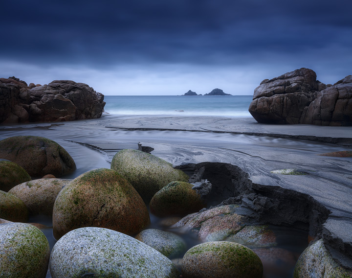The rocky shores of Porth Nanven during blue hour