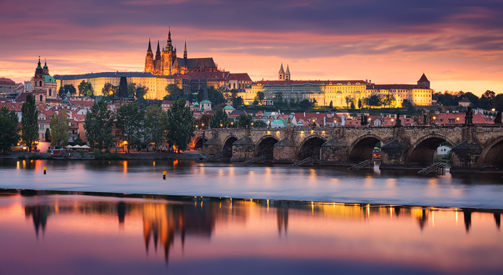 Colorfull skies over Prague and river Moldau