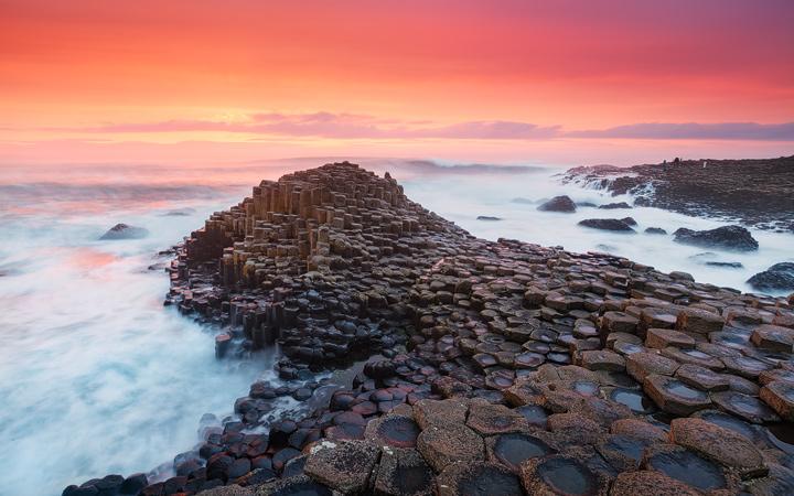 Waves crashing on the rocks of Giants Causeway