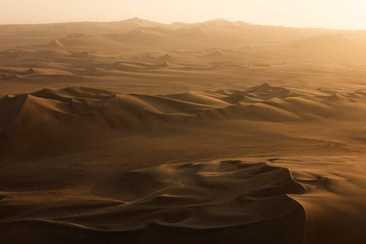 View upon the dune landscape in Huacachina during Sunset