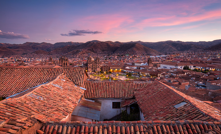 Twilight sets in over andean city of cusco