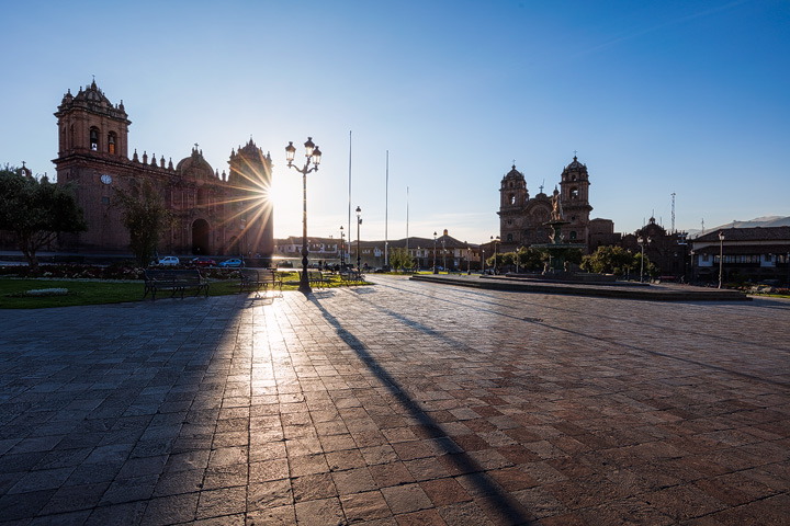 The sun rises behind the Cusco Cathedral