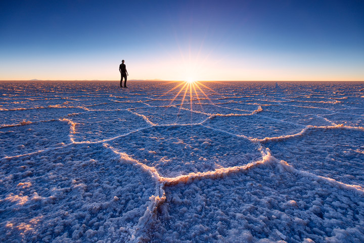 Intricate salt structures glow during sunset in Salar de Uyuni