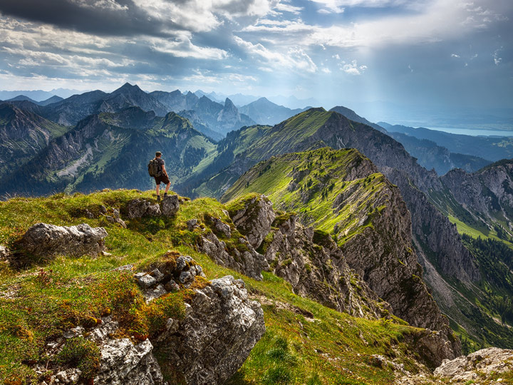 Hiker at a mountain ridge in the german alps
