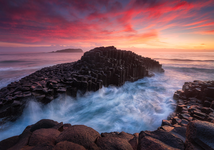 Blazing dawn over the rocks of Fingal Head Causeway