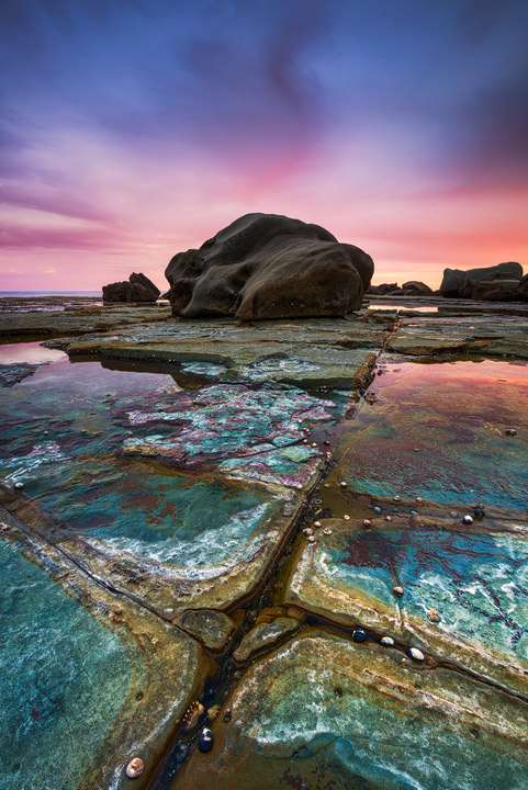 The rock structures at Forresters Beach during Sunset