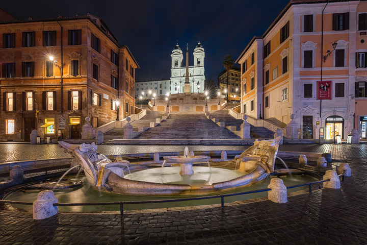 The city lights illuminate the Spanish Steps
