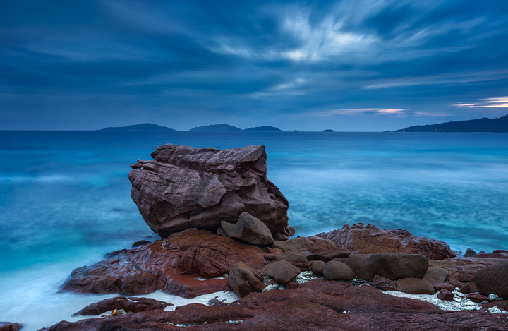 A red granite rock at the northern tip of La Digue