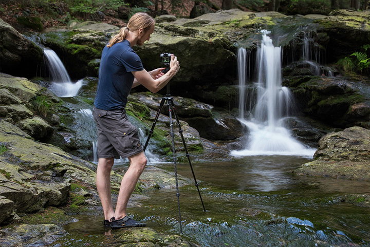Landscape Photographer photographing a waterfall