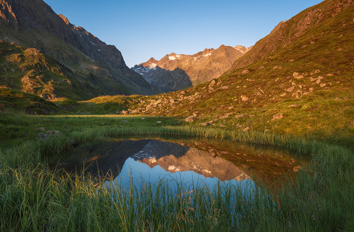 Reflection of the Stubai Mountains in a little lake