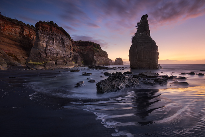 The Three Sisters rock formation at a beach near New Plymouth