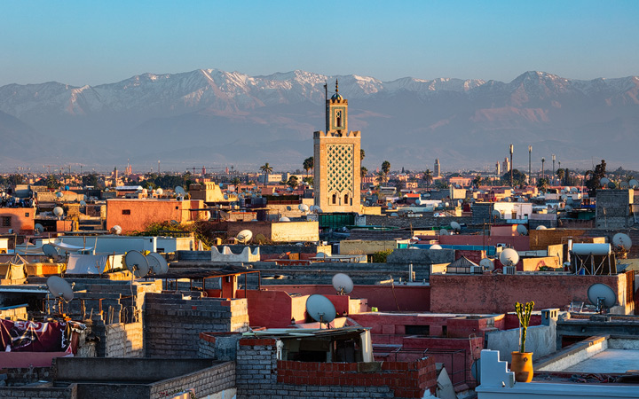 The Atlas Mountains rise behind the city of Marrakech