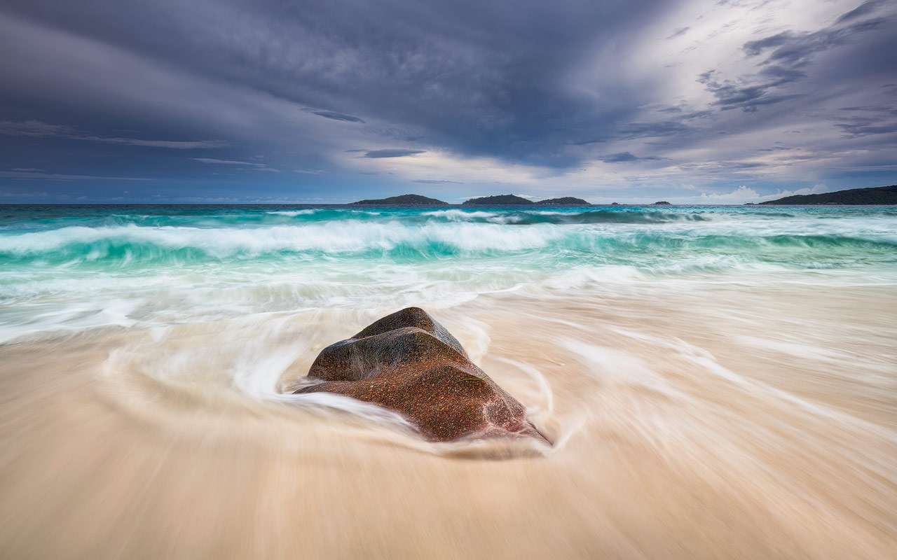 Water flowing back into the sea on a beautiful beach on the Seychelles
