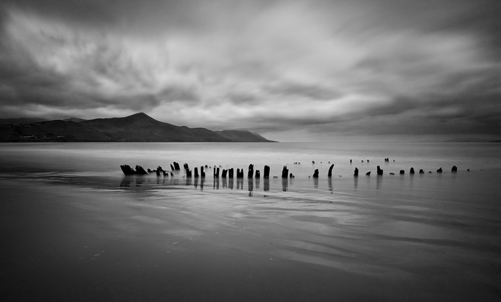 an old shipwreck on rossbeigh beach in kerry ireland