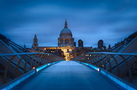 The view of St. Paul's Cathedral from Millennium Bridge during blue hour