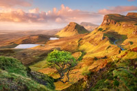 The view from the Quiraing along the Trotternish ridge in pink morning light